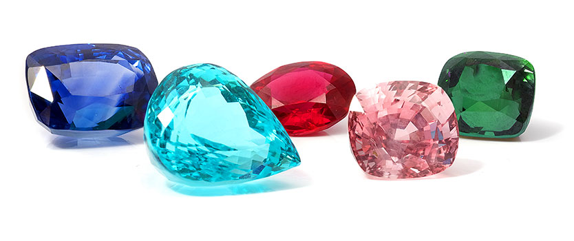 Assorted coloured gemstones of various shapes and sizes