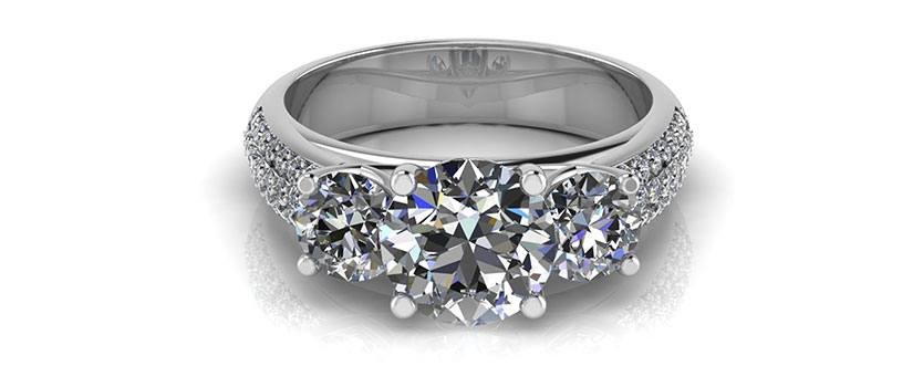 White gold three stone diamond engagement ring with micro pave set diamonds down the band