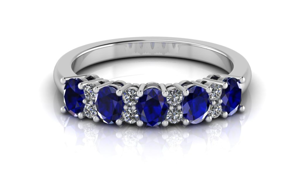 White gold ceylon sapphire band with diamond accents in-between