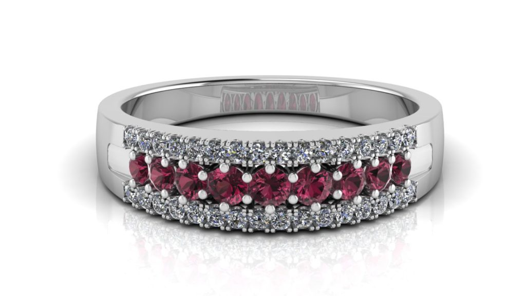 White gold ring featuring a center row of garnets and side rows of diamonds