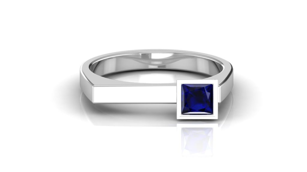 White gold ring featuring offset princess cut ceylon sapphire