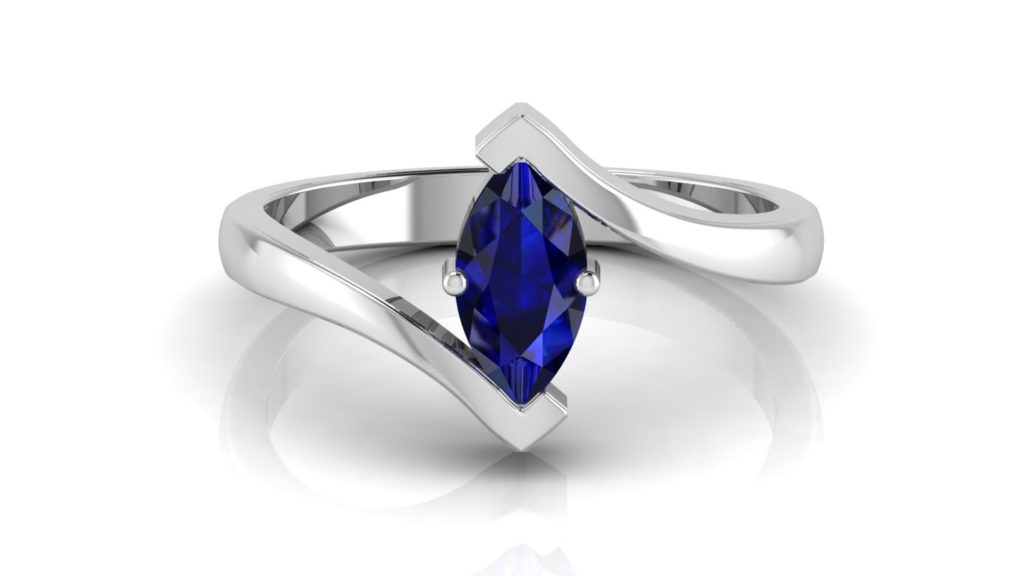 White gold bypass ring featuring a marquise cut ceylon sapphire