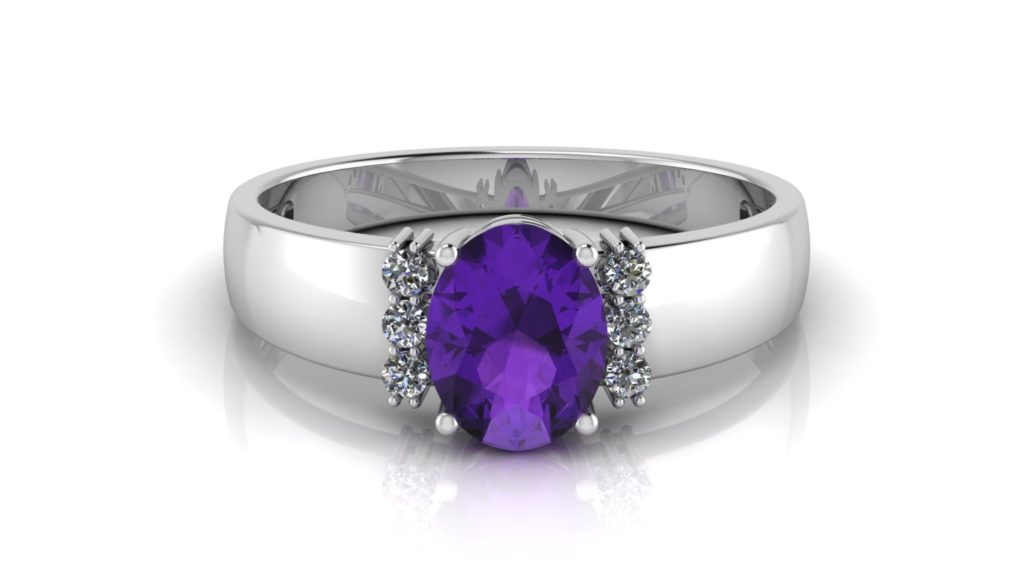 White gold ring featuring an oval cut amethyst and diamond accents