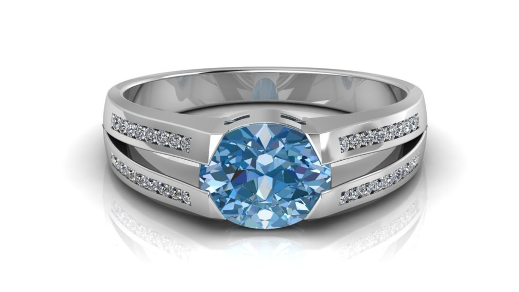 White gold split shank ring featuring an oval blue topaz and pave set diamond accents