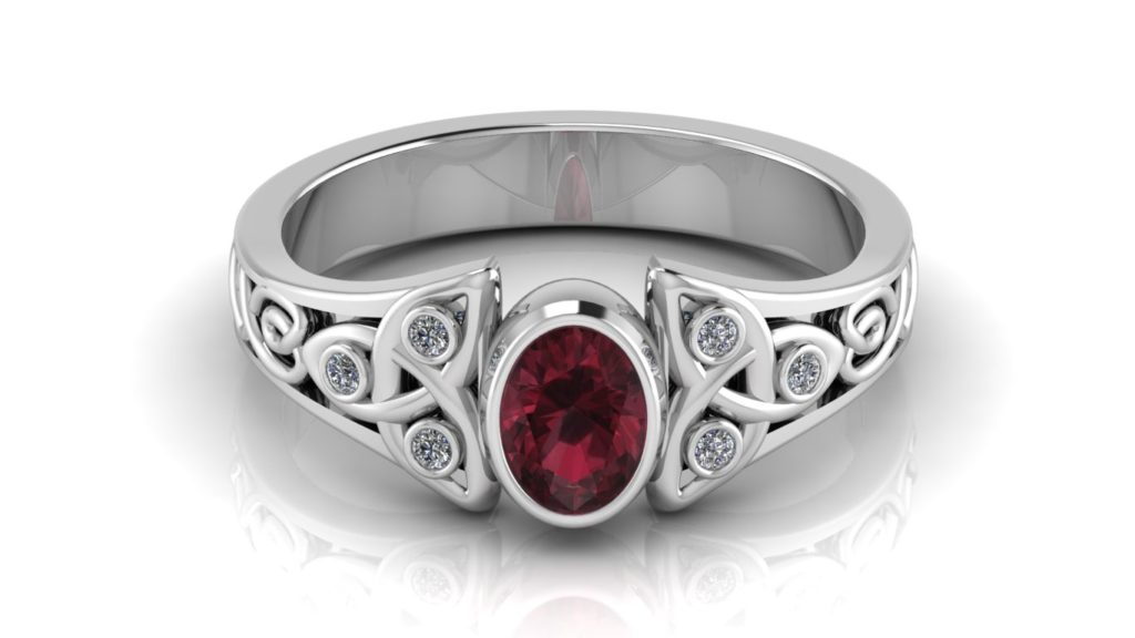 White gold celtic knot ring featuring a bezel set garnet and diamond accents