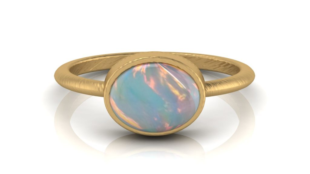 Yellow gold textured bezel set opal ring