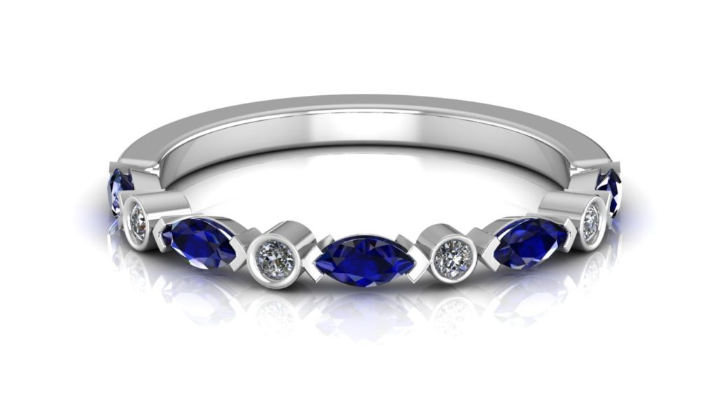 White gold ring featuring alternating round diamonds and marquise cut ceylon sapphires