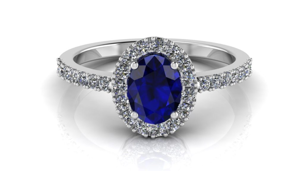White gold diamond halo ring featuring an oval ceylon sapphire center