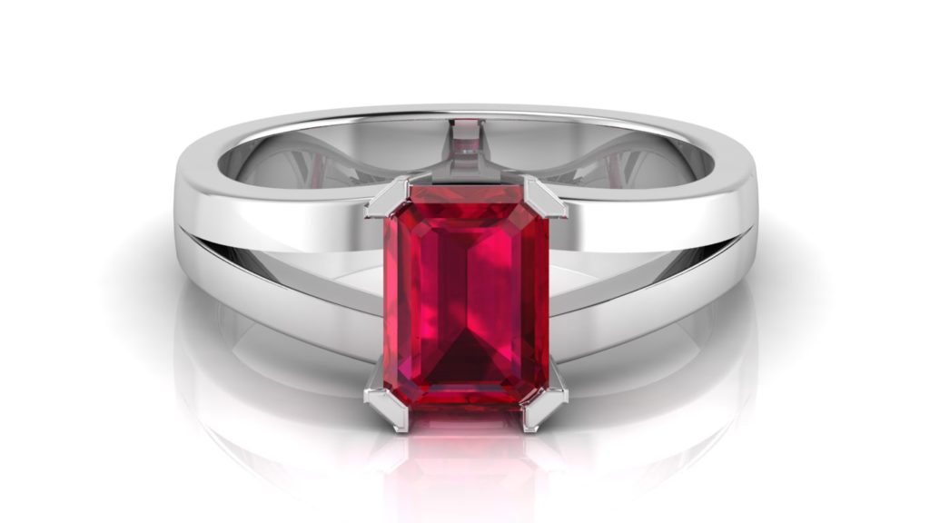 White gold split shank ring featuring an emerald cut ruby