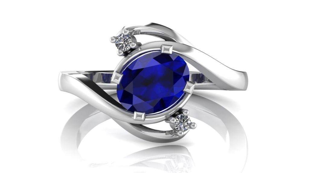 White gold abstract ring featuring an oval ceylon sapphire and diamond accents