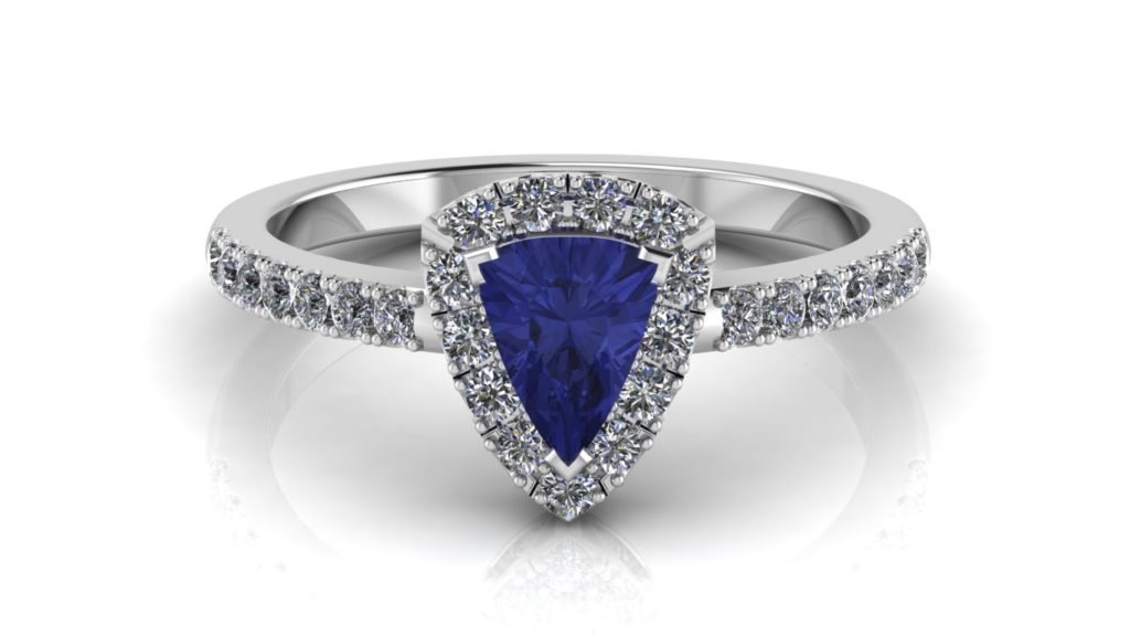 White gold halo ring featuring a trillion cut tanzanite and diamonds