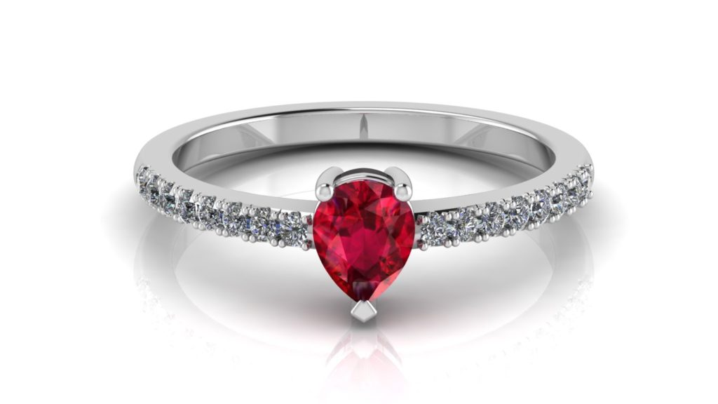White gold ring featuring a pear cut ruby with diamonds
