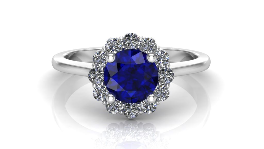 White gold share claw diamond flower halo ring featuring a round ceylon sapphire center