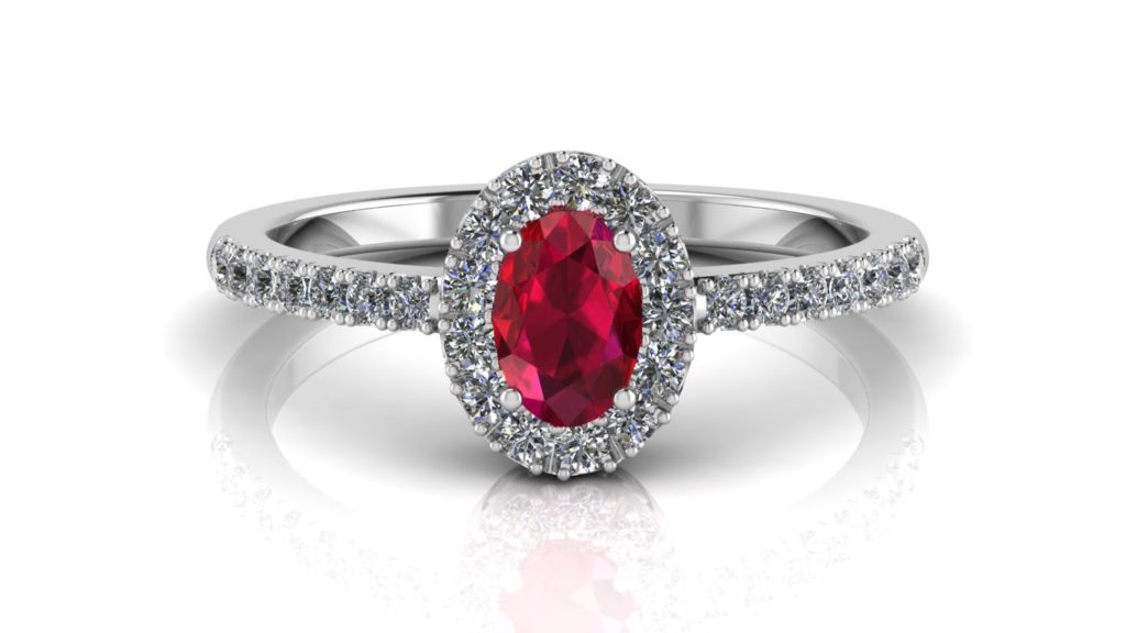 White gold halo ring featuring an oval cut ruby with diamonds
