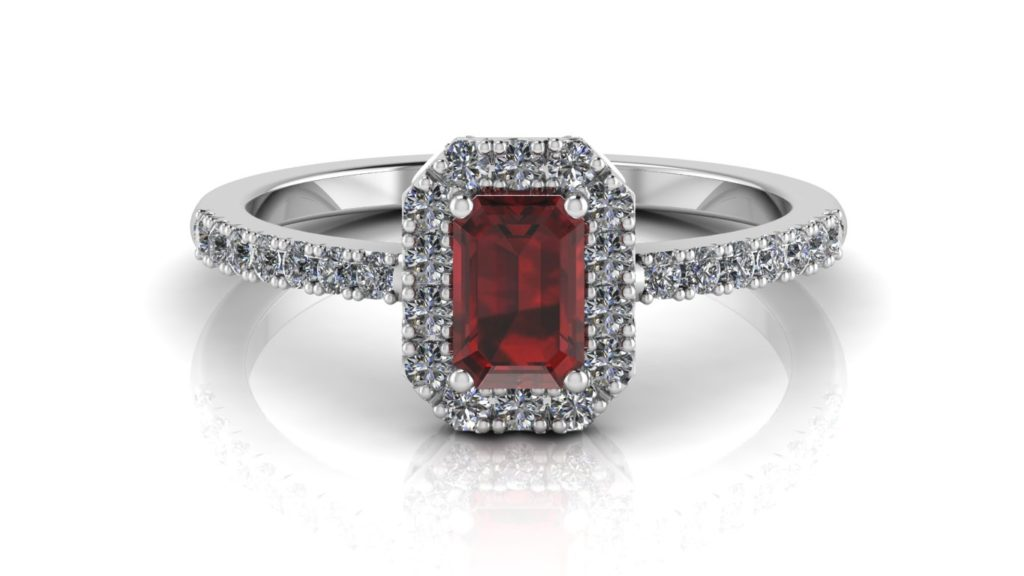 White gold halo ring featuring an emerald cut garnet with diamonds