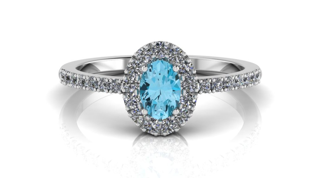 White gold halo ring featuring an oval cut blue topaz with diamonds