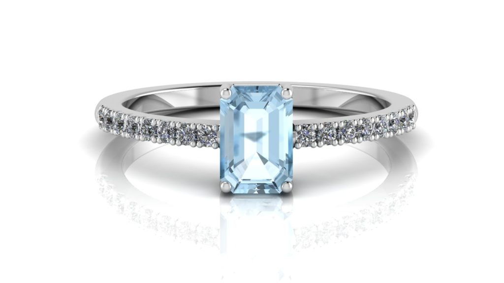 White gold ring featuring an emerald cut aquamarine with diamonds