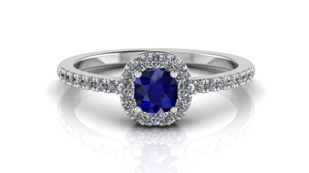White gold halo ring featuring a cushion cut ceylon sapphire with diamonds