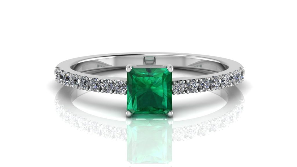 White gold ring featuring a square shaped emerald with diamonds