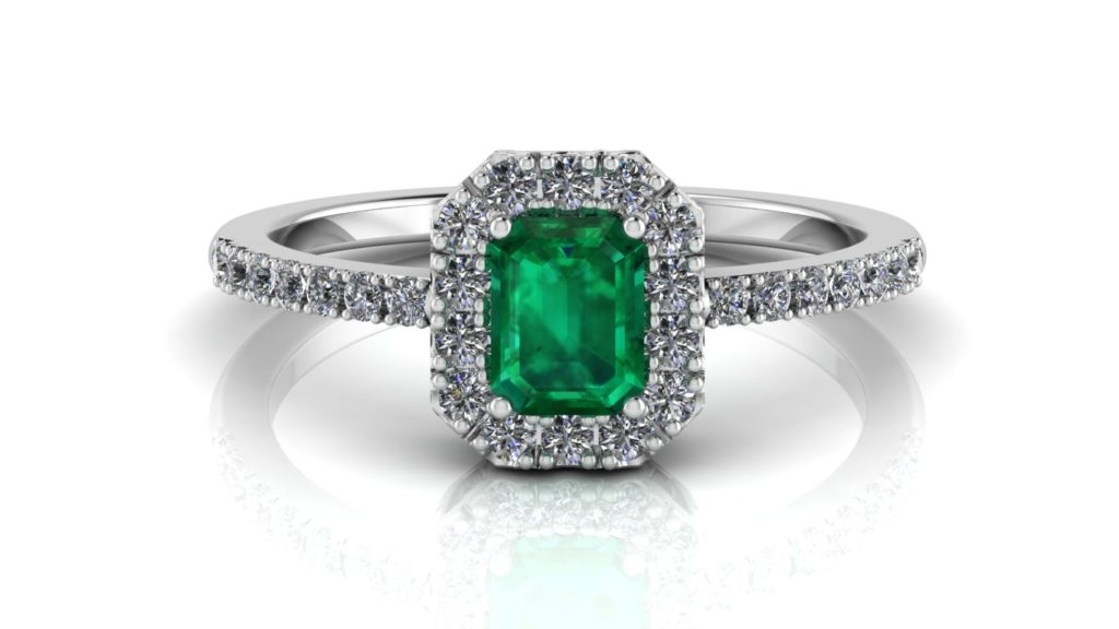 White gold halo ring featuring an emerald with diamonds