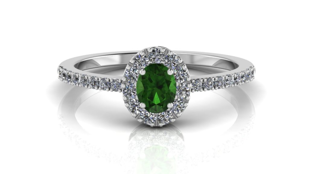 White gold halo ring featuring an oval tsavorite with diamonds