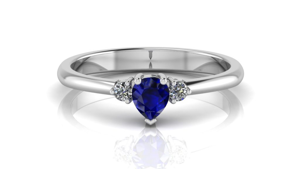 White gold ring featuring a pear cut ceylon sapphire with round side diamonds