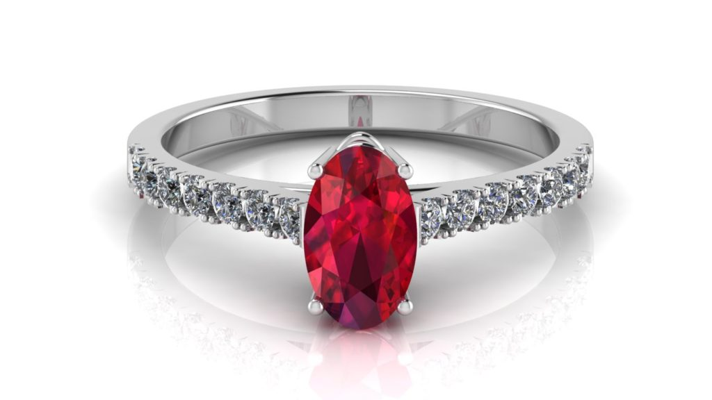 White gold ring featuring an oval ruby with diamonds