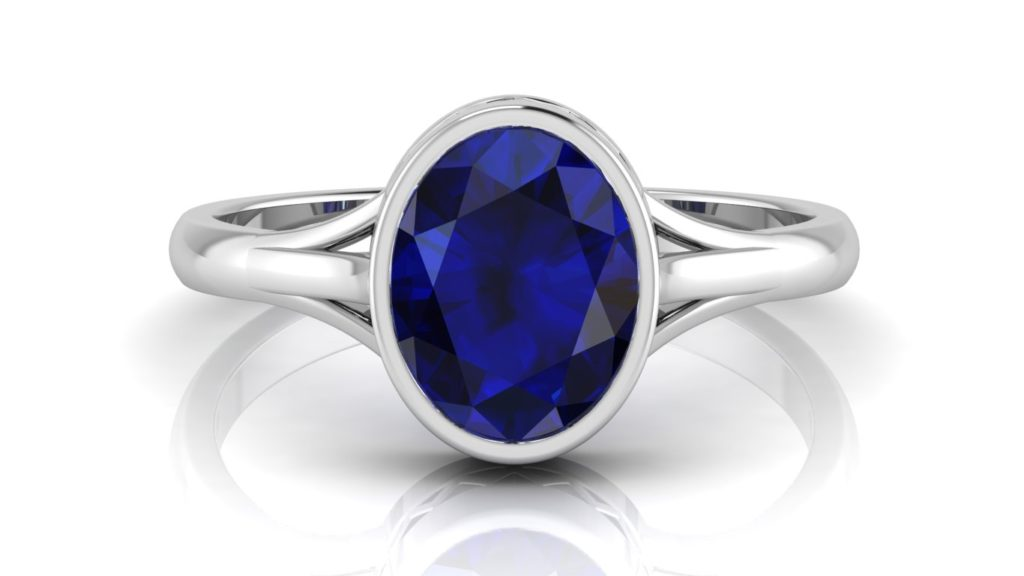 White gold ring featuring a bezel set ceylon sapphire