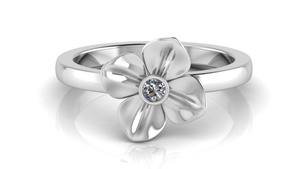 White gold flower ring featuring a bezel set diamond