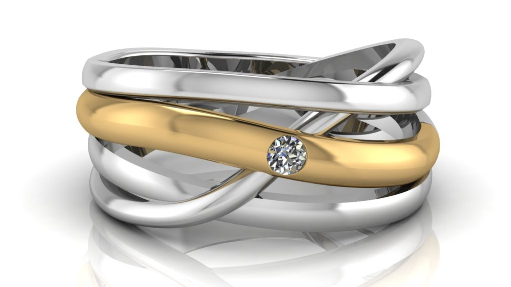 Yellow & white gold abstract cross-over ring featuring a flush set diamond