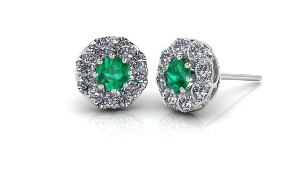 White gold halo studs featuring emerald and diamonds