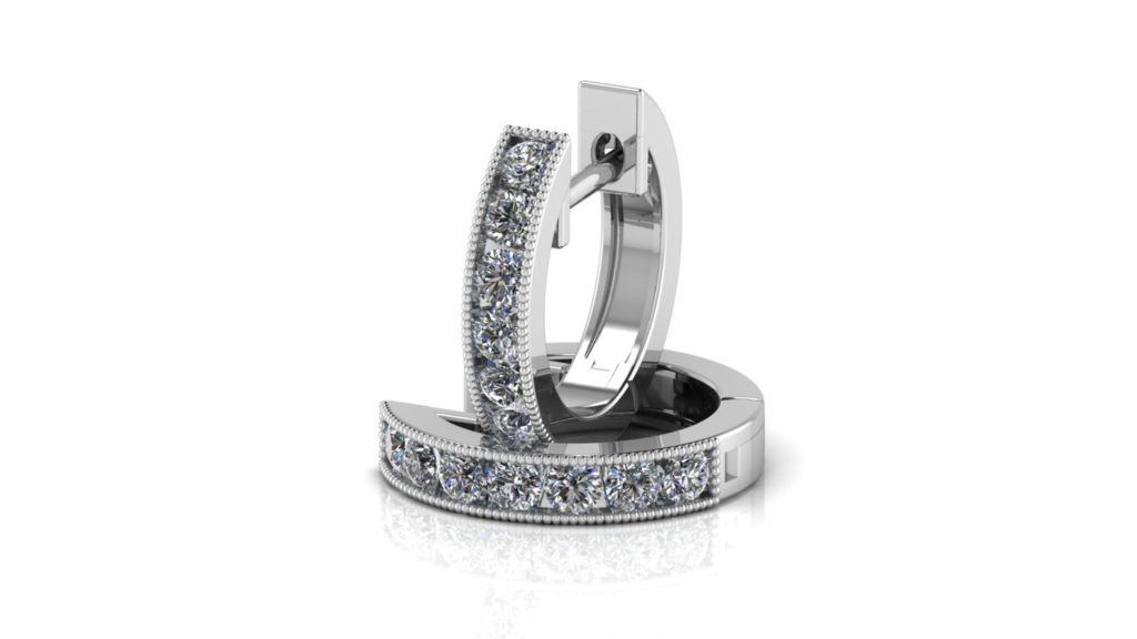 White gold channel set lever back hoops with diamonds and milgrain accents
