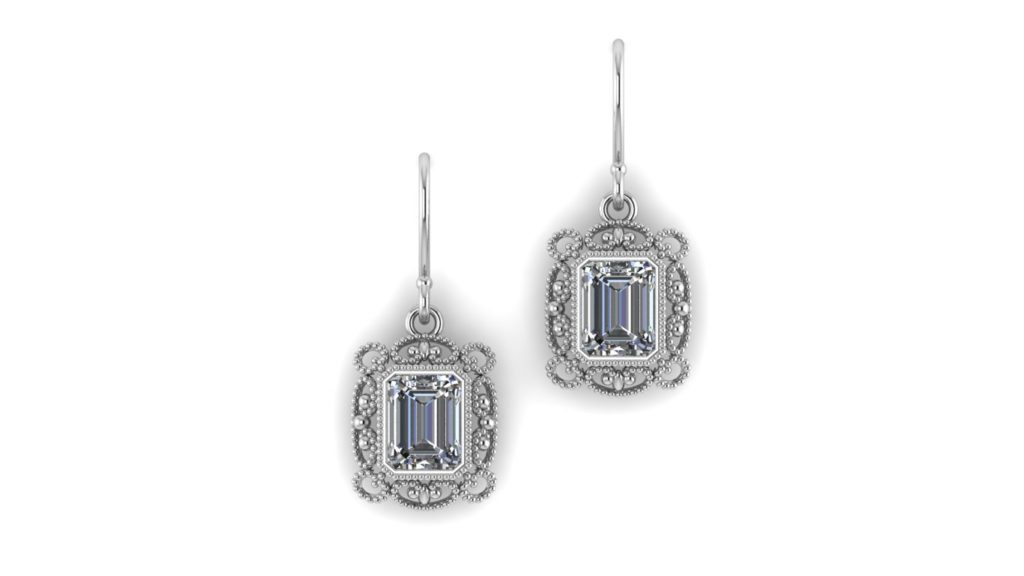 White gold vintage style earrings featuring emeral cut diamonds with milgrain accents