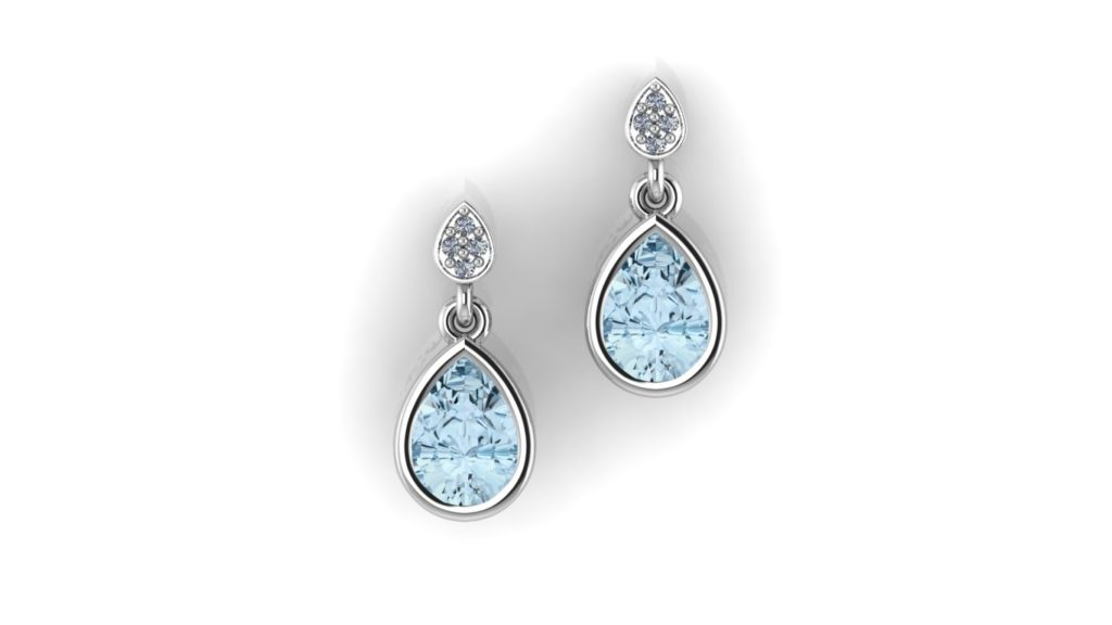 White gold studs featuring a bezel set blue topaz and accent diamonds