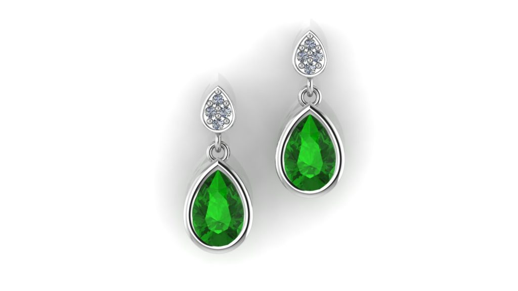 White gold studs featuring a bezel set tsavorite and accent diamonds