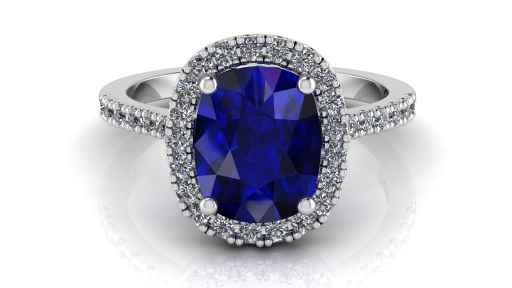 White gold halo engagement ring featuring a cushion cut ceylon sapphire with diamonds