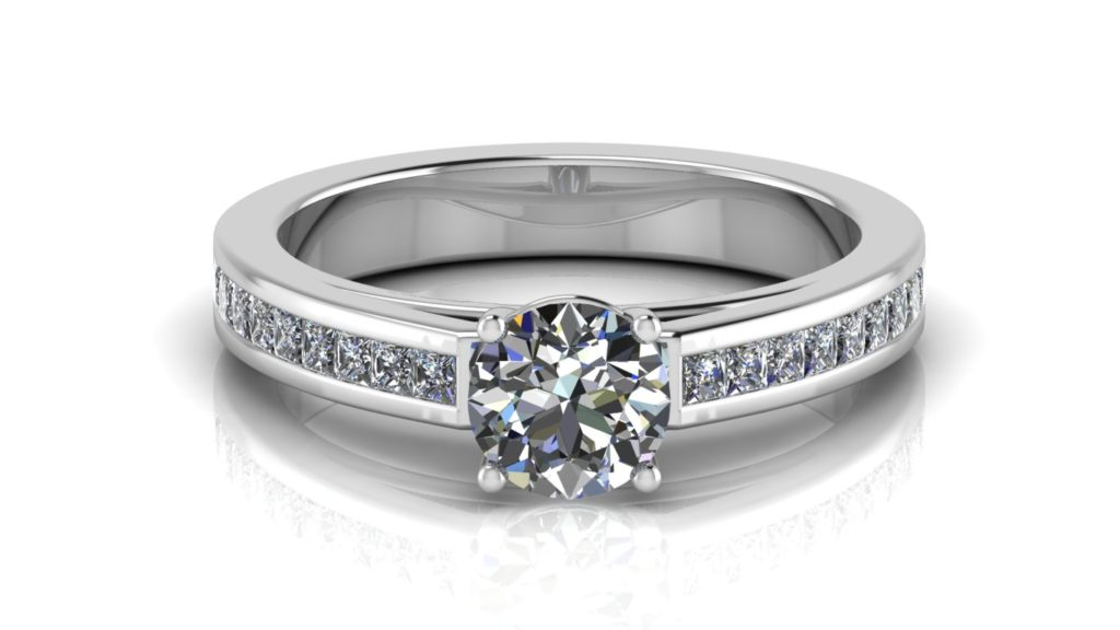 White gold engagement ring featuring a claw set round diamond and smaller channel set princess cuts down the band