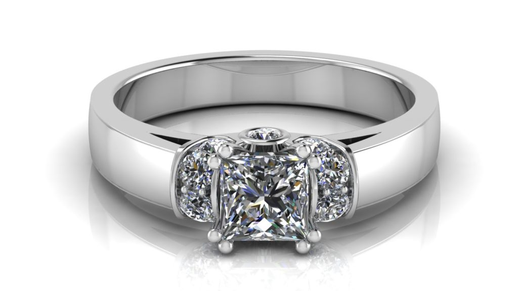 White gold engagement ring featuring a double claw set princess cut diamond with pave set diamond accent