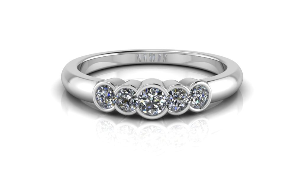 White gold ladies half bezel set ring featuring five diamonds