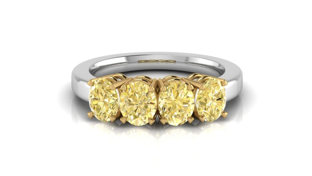 Yellow & white gold ladies ring featuring four natural oval cut yellow diamonds