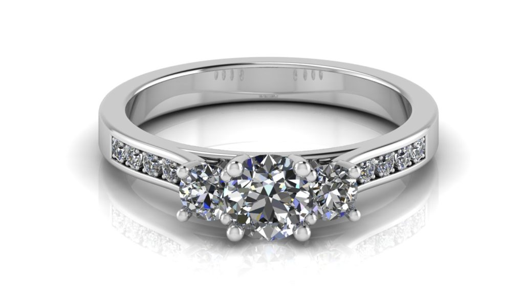 White gold three stone diamond engagement ring with pave set diamonds down the band