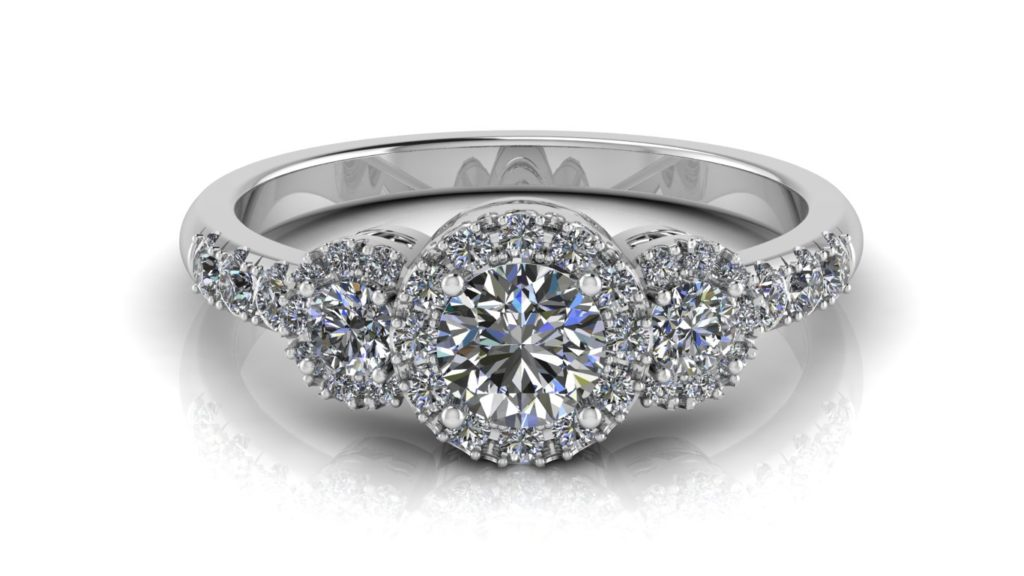 White gold halo engagement ring featuring three round diamonds and smaller diamonds down the band