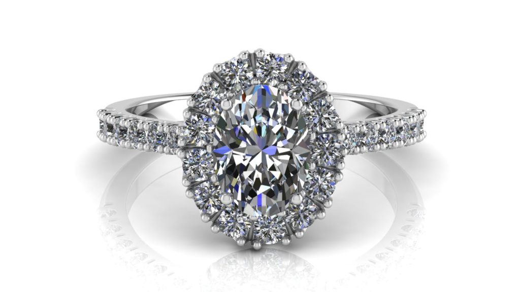White gold halo engagement ring featuring an oval cut diamond with smaller diamonds down the band