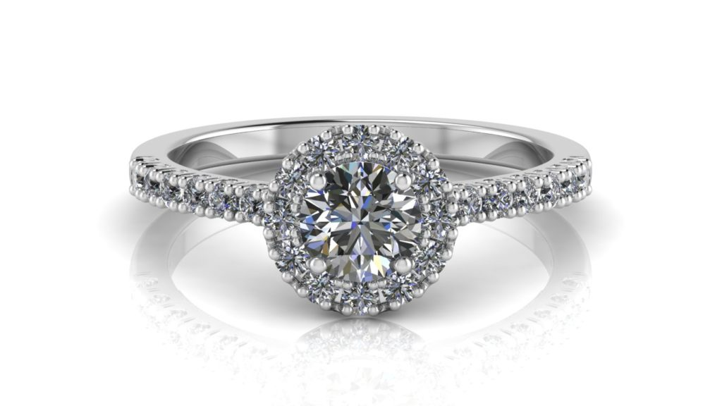 White gold halo engagement ring featuring a round diamond with smaller diamonds down the band