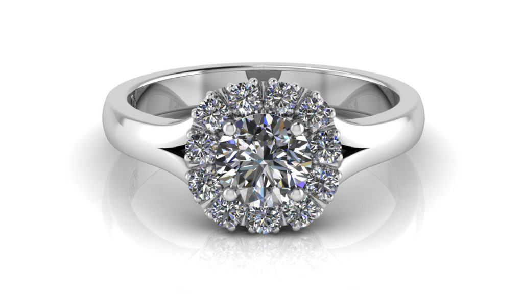 White gold engagement ring featuring a claw set round diamond and cushion shaped diamond halo