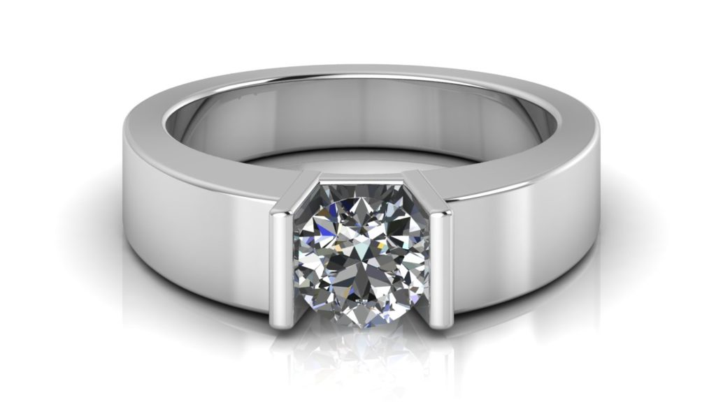 White gold engagement ring featuring a bar set round diamond