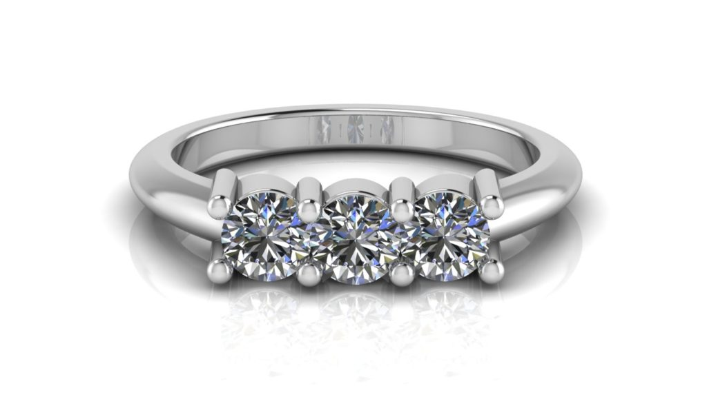 White gold three stone engagement ring featuring claw set round diamonds