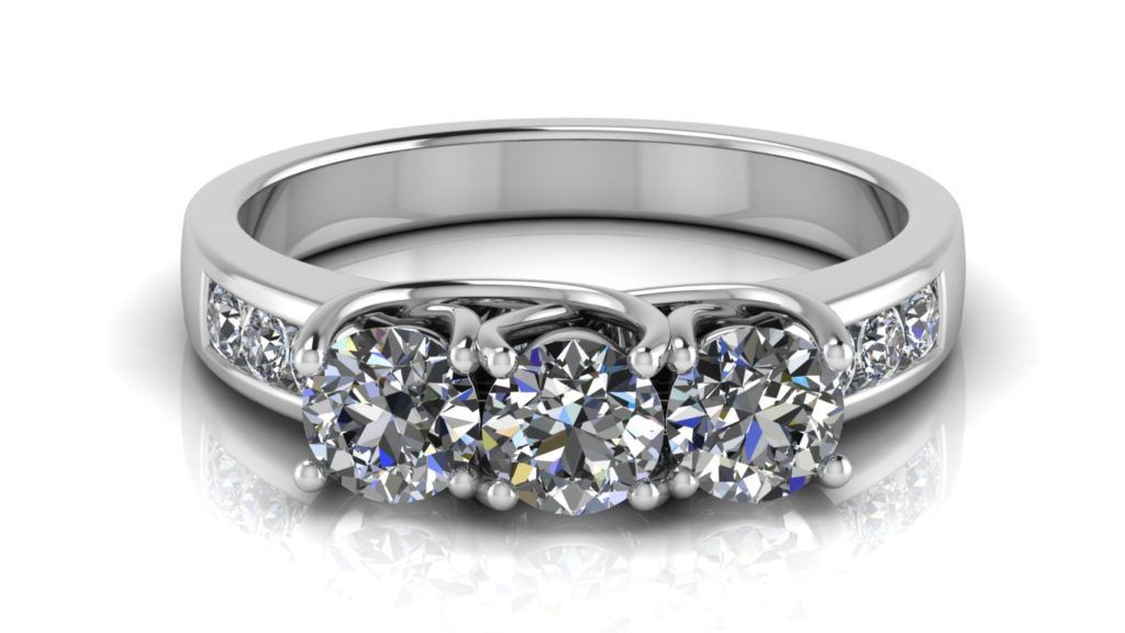 White gold three stone engagement ring with smaller channel set diamonds down the band