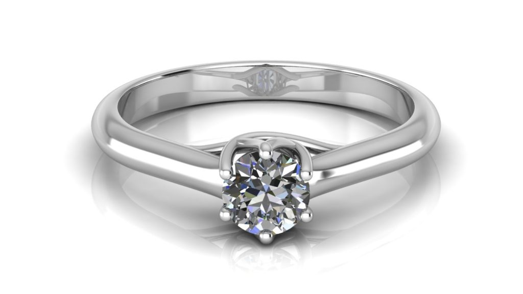 White gold solitaire engagement ring featuring a claw set round diamond