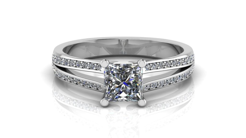 White gold split shank engagement ring featuring a princess cut diamond with pave set diamonds down the band